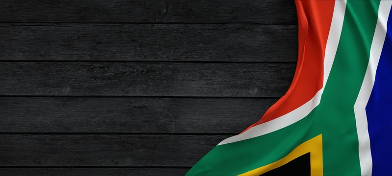 Flag of the South Africa, fabric on dark wood.