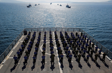 Crew members of the amphibious landing ship tank (LST) TCG Bayraktar (L-402) pose after a landing drill during the Blue Homeland naval exercise off the Aegean coastal town of Foca in Izmir Bay