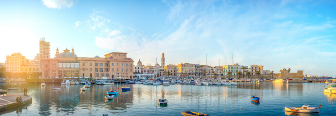 Bari, Puglia, Italy - Panoramic view of waterfront and harbor with boats - Margherita theater, cathedral and fort of Sant'Antonio. Panorama at sunset Wall mural