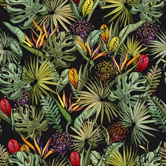 Seamless pattern with colorful exotic flowers and green tropical leaves. Hand drawn vector on black background.