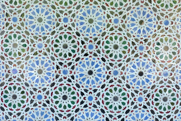 Arabic pattern on a tiled wall of a Muslim building, abstract background and texture