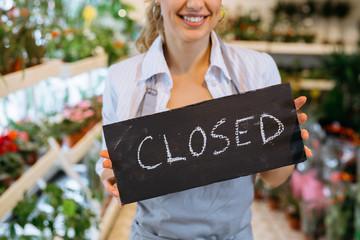 closeup of florist holding close sign
