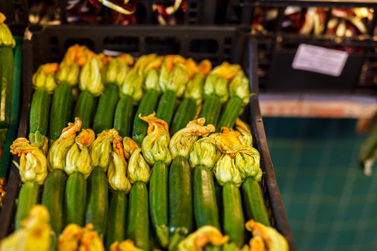 Zucchini flower blossoms in a crate at an Italian farmers market