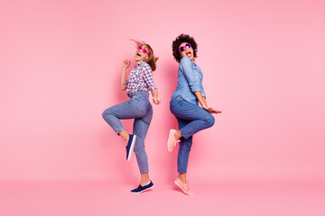 Full length body size profile side view portrait of two person nice crazy carefree attractive charming playful cheery girls in casual checkered shirt having fun isolated over pink pastel background