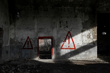 Danger signs are seen at a bankrupt glue factory at the outskirts of Belgrade