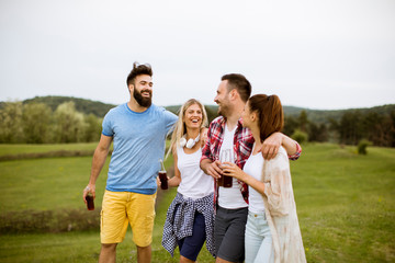 Happy group of friends having fun and smiling at nature