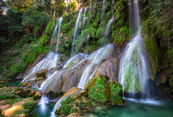 El Nicho Waterfalls in Cuba. El Nicho is located inside the Gran Parque Natural Topes de Collantes a forested park that extends across the Sierra Escambray mountain range in central Cuba.