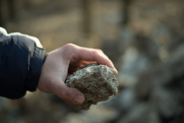 stone in man's hand