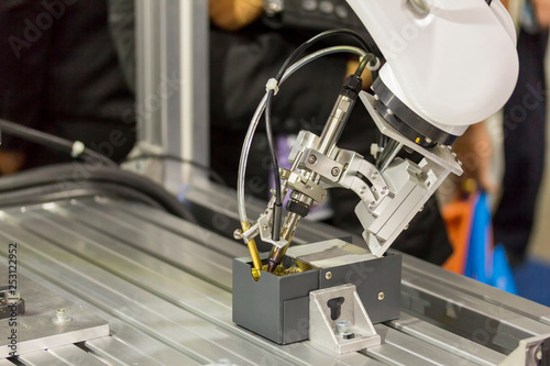 close up cleaning process soldering iron tips of robotic system for