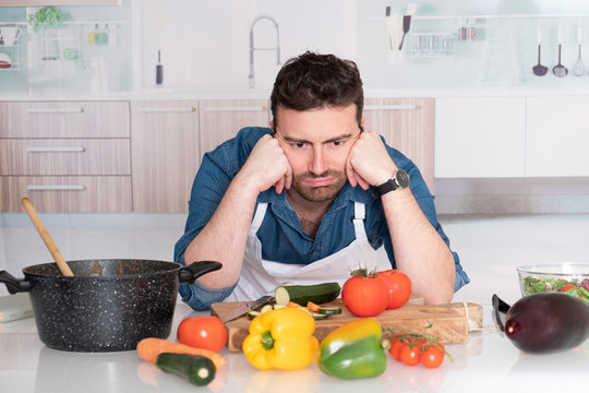 Sad and frustrated man with kitchen fails