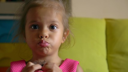 little asian girl, eat chocolate, funny child, close-up portrait
