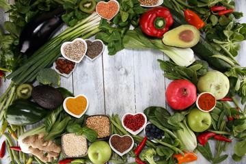 Healthy food clean eating selection. fruit, vegetable, seeds, superfood, cereals, leaf vegetable on rustic background