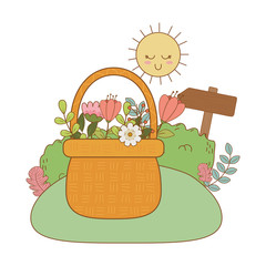 cute basket straw with flowers in the landscape