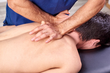 Physiotherapist giving a back massage. Chiropractic, osteopathy, manual therapy, acupressure