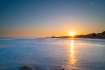 Sunset over the mediterranean sea on thegolden hour. Sitges, Spain.