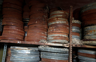 Film reel canisters are seen in a former cinema in Tulkarm in the Israeli-occupied West Bank