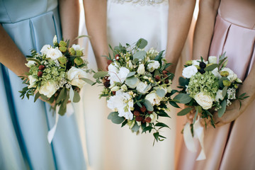 bride  and her girlfriends holding a wedding bouquet