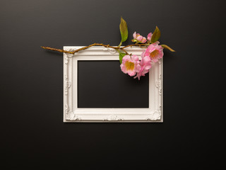 white frame on black background with cherry blossoms