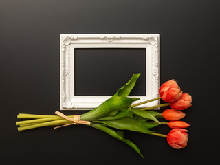 white frame on black background with tulip flowers