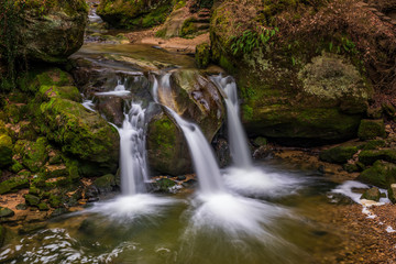 The Schiessentümpel is a small and picturesque waterfall on the Black Ernz river. Mullerthal - Luxembourg's Little Switzerland.