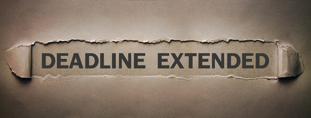 Deadline Extended text on torn paper.