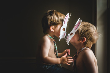 Little easter bunny boys giving a bunny kiss