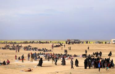 A general view of people walking near Baghouz, Deir Al Zor province