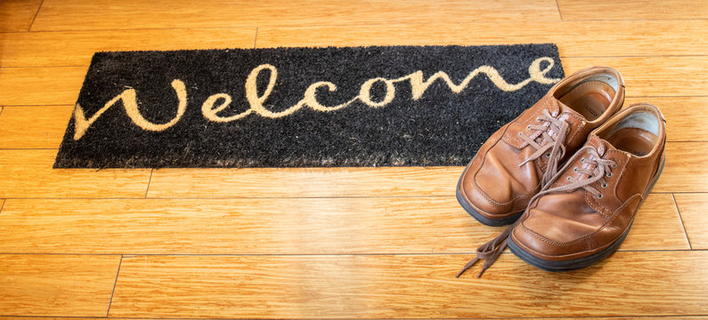 Welcome home mat with brown shoes