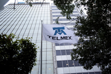 A flag showing the logo of internet and fixed-line phone company Telmex is pictured at its headquarters in Mexico City