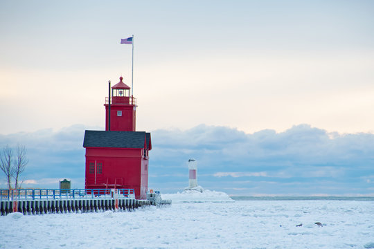 Big Red lighthouse in Holland Harbor channel in winter