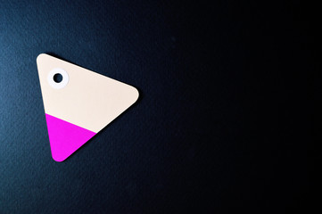 triangle paper tag on dark background horizontal template