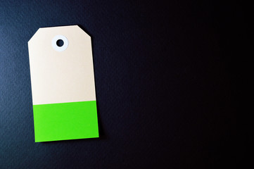 vectical clipped rectangle paper tag on dark background
