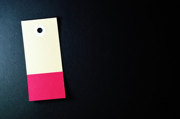 vectical rectangle paper tag on dark background