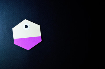 hexagon paper tag on dark background