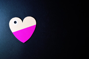 heart paper tag on dark background