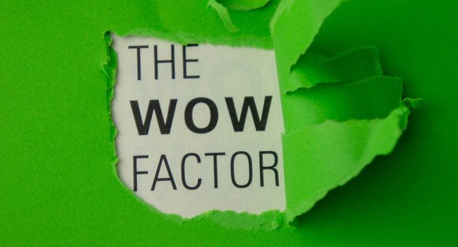 Torn paper with text The wow factor. Motivational concept