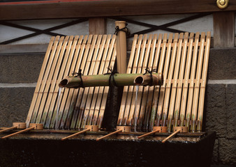 Japanese bamboo drinking water system with water flowing background