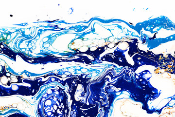 Hand painted background with mixed liquid blue, white, yellow paints. Abstract fluid acrylic painting. Applicable for packaging, invitation, textile, wallpaper, design of different surfaces