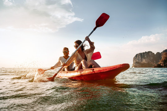 Happy couple walks by sea kayak or canoe