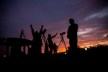 A happy hour for group of photographers in twilight time beautiful sky background