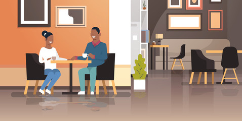 young couple drinking coffee together sitting cafe table african american man woman romantic love dating concept modern restaurant interior flat horizontal
