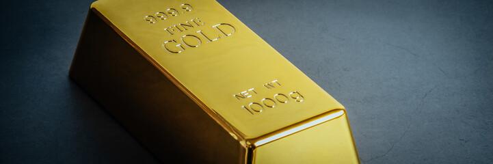 Gold bar ingot bullion on blue background. Located diagonally.