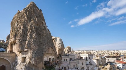 Wall Mural - Cappadocia cave with view of city skyline time lapse in Goreme, Turkey