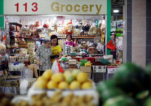 Hawker Leong Yuet Meng, 90, of Nam Seng Noodle House, does her daily shopping for ingredients at a market in Singapore