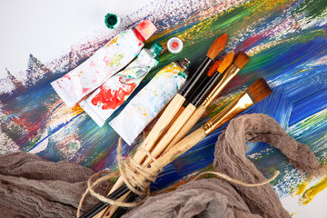 Paint brushes and paints for drawing.