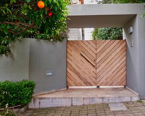elegant modern house entrance wooden door, Athens Greece
