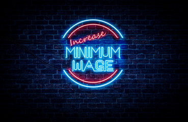 A neon sign in blue and red light on a brick wall background that reads: INCREASE MINIMUM WAGE