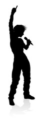 A woman singer pop, country music, rock star or even hiphop rapper artist vocalist singing in silhouette