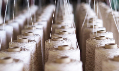 Row of textile threads industry . Fototapete
