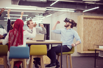 Young Multiethnic Business team using virtual reality headset